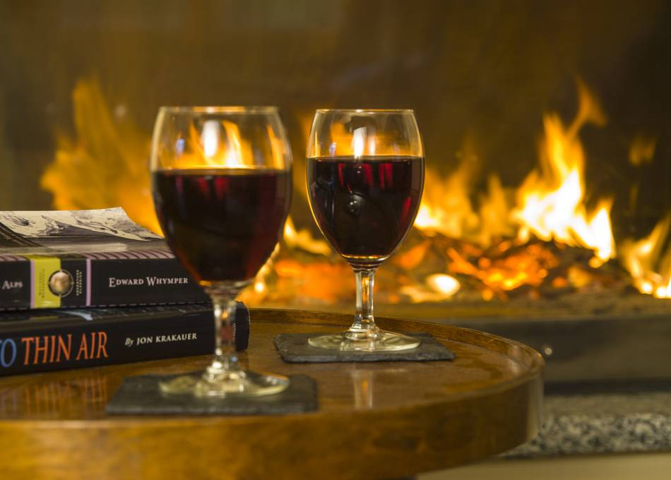 Enjoy a glass of wine by the fire